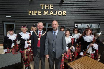 Dagenham Girl Pipers celebrate the new Pipe Major