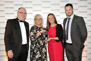 Jo Wyke and Brand Manager Elliot Allison collecting the award